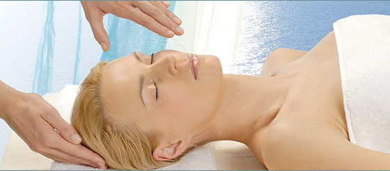 Lady lying on a massage bed
